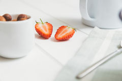 Strawberry cut in half. And nuts to be served with breakfast Royalty Free Stock Photo