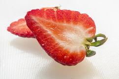 Strawberry cut on white background Royalty Free Stock Photography