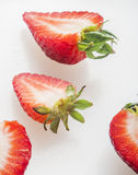 Strawberry cut on white background Royalty Free Stock Images