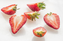 Strawberry cut on white background Royalty Free Stock Photo
