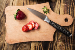 Strawberry on cutting board and knife Stock Image