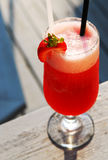 Strawberry daiquiri. Cold strawberry daiquiri beverage served on an outdoor patio royalty free stock photos