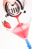 Strawberry Daiquiri being poured into a glass Royalty Free Stock Images