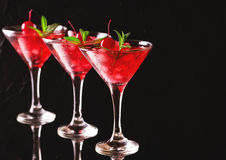 Strawberry daiquiri cocktail with lime, strawberry, cherry and m Stock Photos