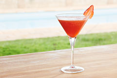 Strawberry daiquiri cocktail by a pool outdoors Royalty Free Stock Photos
