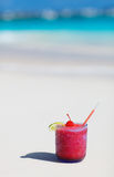 Tropical cocktail on white sand beach Royalty Free Stock Photos