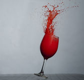 Strawberry Daiquiri Splash. Spilling of a strawberry liquid from a glass Stock Images