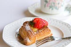 Strawberry Danish. On china plate stock photos