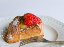 Strawberry Danish. On china plate royalty free stock image