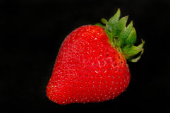 Strawberry in the dark Royalty Free Stock Images