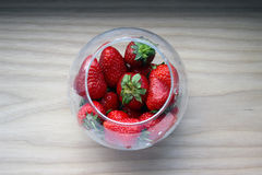 Strawberry. Delicious strawberry is a symbol of summer. Strawberries in a glass jar Royalty Free Stock Image
