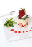 Strawberry Dessert. A colorful gourmet strawberry dessert cake on a plate Stock Photo