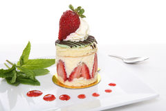 Strawberry Dessert. A delicious strawberry dessert cake on a white background Stock Photography