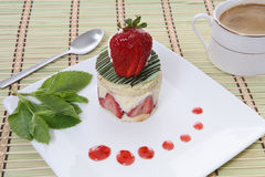Strawberry Dessert. A colorful gourmet strawberry dessert cake on a plate Royalty Free Stock Photography