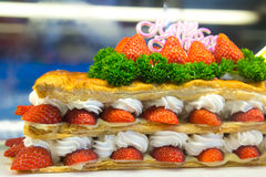 Strawberry dessert. Slice of delicious multi layers strawberry cake Royalty Free Stock Photography