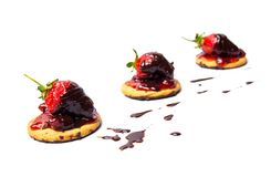 Strawberry dessert on a biscuit with jam. Isolated fruit chocolate cookie white red background candy nobody shape sugar jelly seasonal fresh morning food stock photos