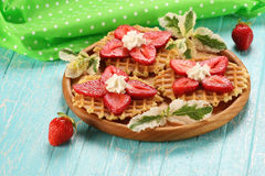Strawberry dessert with cream on a wooden platter Royalty Free Stock Images