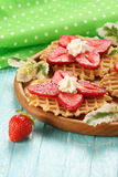 Strawberry dessert with cream on a wooden platter Royalty Free Stock Photography