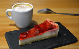 Strawberry dessert with cup of cappuccino on the wooden table Stock Photo