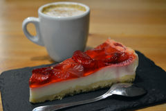 Strawberry dessert with cup of cappuccino on the wooden table Stock Photos