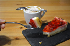 Strawberry dessert with cup of cappuccino on the wooden table Stock Images