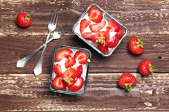 Strawberry dessert in a glass bowl Stock Images
