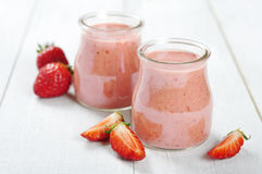 Strawberry dessert. In glass jars and fresh strawberry on a wooden background Stock Photography