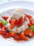 Strawberry dessert with ice cream Stock Images