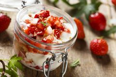 Strawberry dessert with whipped cream. Strawberry dessert in a jar with whipped cream and fresh berries Royalty Free Stock Photography