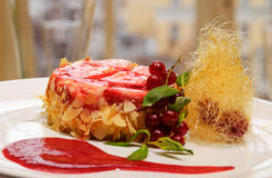 Strawberry dessert. On a white dish Stock Photos