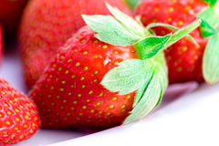 Strawberry detail. Detail of leafed and fresh strawberry bowl Stock Photo