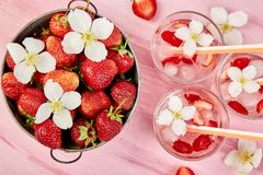 Strawberry detox water with jasmine flower. Summer iced drink or tea. Lemonade with berry. Flavored Water in glasses with Fresh. Strawberry. Copy Space. Diet royalty free stock photo