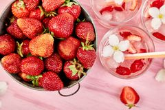 Strawberry detox water with jasmine flower. Summer iced drink or tea. Lemonade with berry. Flavored Water in glasses with Fresh. Strawberry. Copy Space. Diet royalty free stock image
