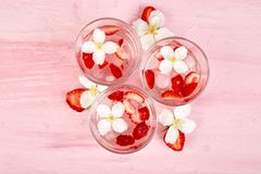 Strawberry detox water with jasmine flower. Summer iced drink. Or tea. Lemonade with berry. Flavored Water in glasses with Fresh Strawberry. Copy Space. Diet royalty free stock photos