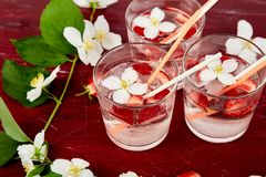 Strawberry detox water with jasmine flower. Summer iced drink. Or tea. Lemonade with berry. Flavored Water in glasses with Fresh Strawberry. Diet stock photo