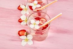 Strawberry detox water with jasmine flower. Summer iced drink. Or tea. Lemonade with berry. Flavored Water in glasses with Fresh Strawberry. Diet stock photos