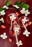 Strawberry detox water with jasmine flower. Summer iced drink or tea. Lemonade with berry. Flavored Water in glasses with Fresh Strawberry. Copy Space. Diet stock photos