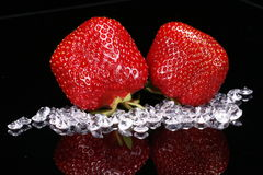 Strawberry Diamonds. Two fresh strawberries with diamonds on a black glass Royalty Free Stock Images