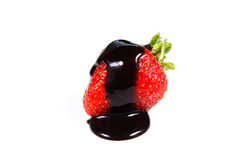 Strawberry dipped in chocolate fondue. Valentine's day on a white background Stock Images