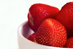 Strawberry in dish. On thumped background Stock Image
