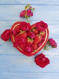 Strawberry dish heart, flower rose on colored wooden background. Strawberry dish heart flower rose on colored wooden background Royalty Free Stock Photo