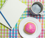 Strawberry Donut with Hot black coffee with notebook Stock Images