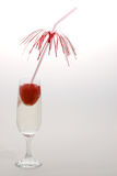 Strawberry drink. Champagne and strawberries royalty free stock image