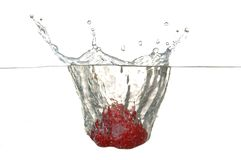 Strawberry drop into glass Royalty Free Stock Photography