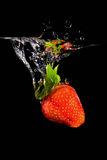 Strawberry drop into water Royalty Free Stock Image