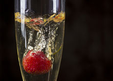 Strawberry dropped in a glass Stock Images