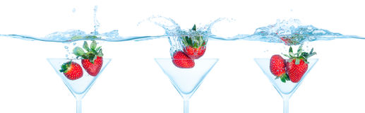Strawberry Dropped into Water Stock Photography