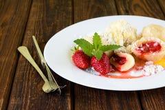Strawberry dumplings on white plate Stock Photos