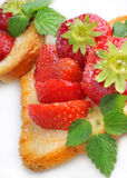 Strawberry on english toast. Fresh strawberry on english toast with sugar Royalty Free Stock Photography