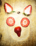 Strawberry face Stock Image